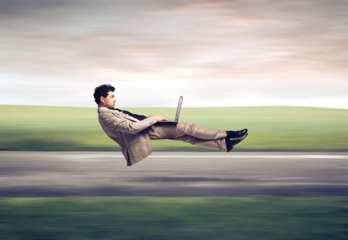 Man uses laptop while levitating at high speed