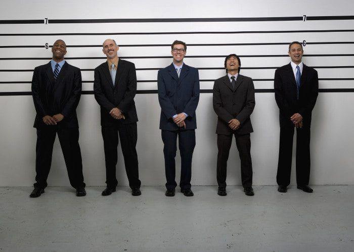 Businessmen standing in line