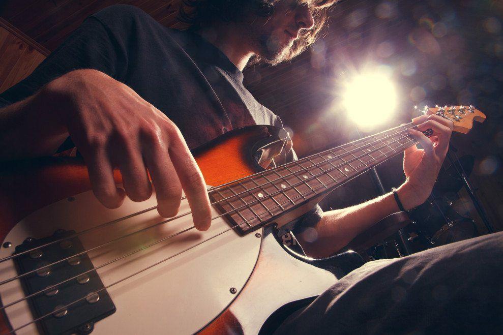 A man plays guitar.