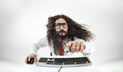 A geek is using a keyboard