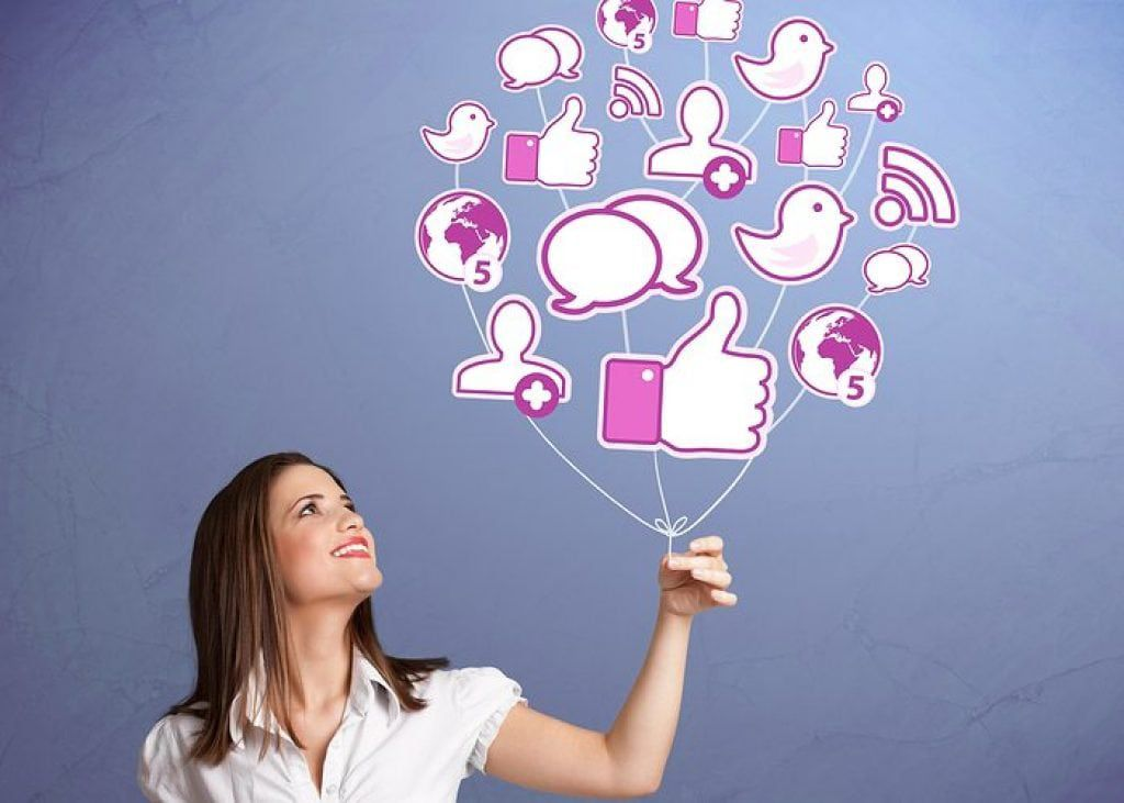 Woman Holding a network of social media showing importance in medical websites