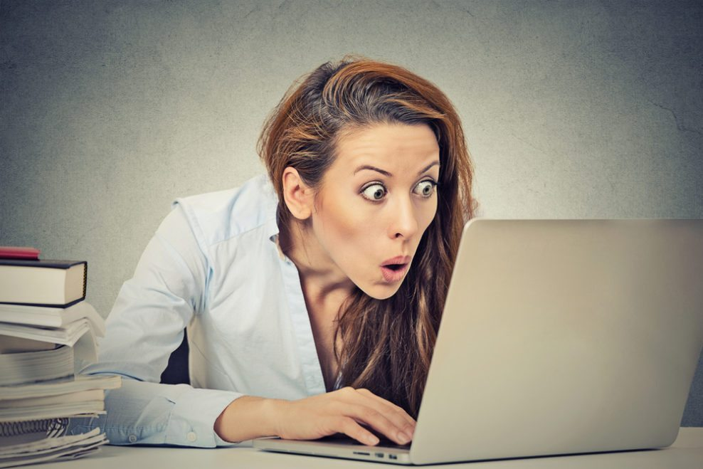 Woman looking shocked at a computer screen, to watch out for mistakes