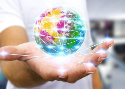 Hand Holding the world showing network of servers for website hosting