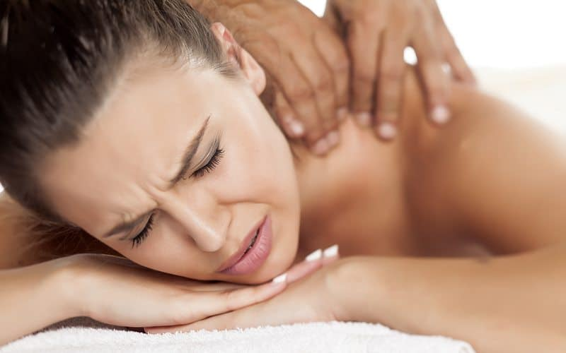 Woman having unpleasant experience at Chiropractors