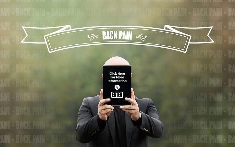 Man holding enter sign for back pain