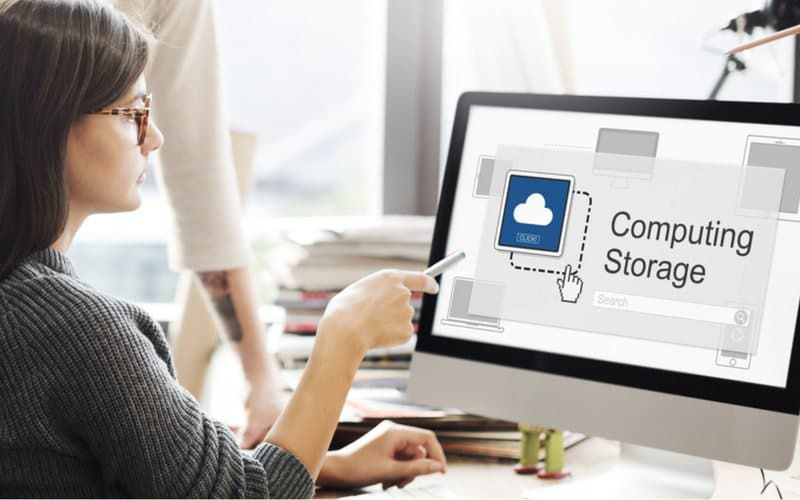 Lady pointing at Cloud Storage