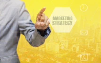 Guy clicking on Marketing Strategy Bubble