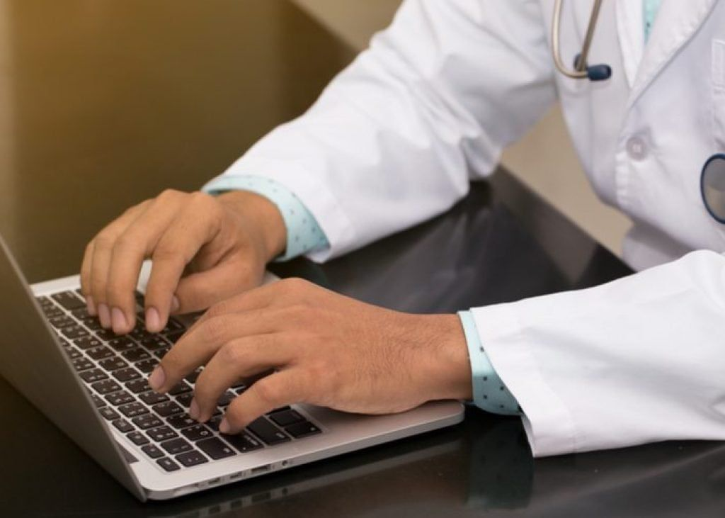 Doctor on his laptop