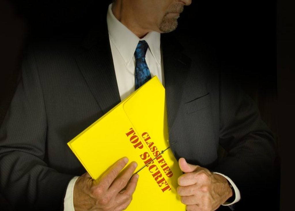 Business Man holding a top secret folder
