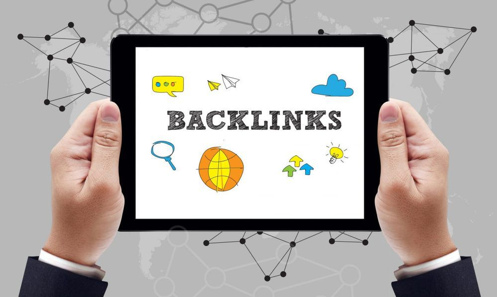 """""""Backlink"""" wording displayed on tablet surrounded by various icons"""