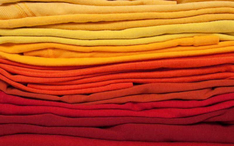 Stacked linens of warm colors