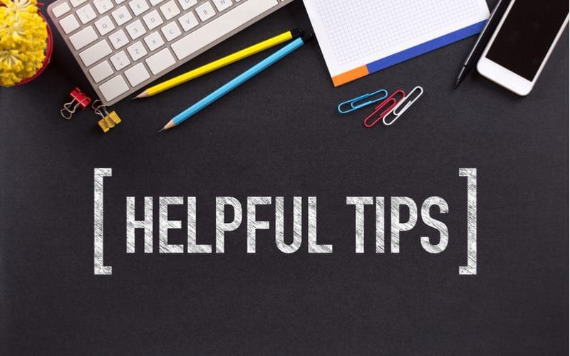 """Image of a laptop surrounded by various office supplies and wording """"Helpful Tips"""""""