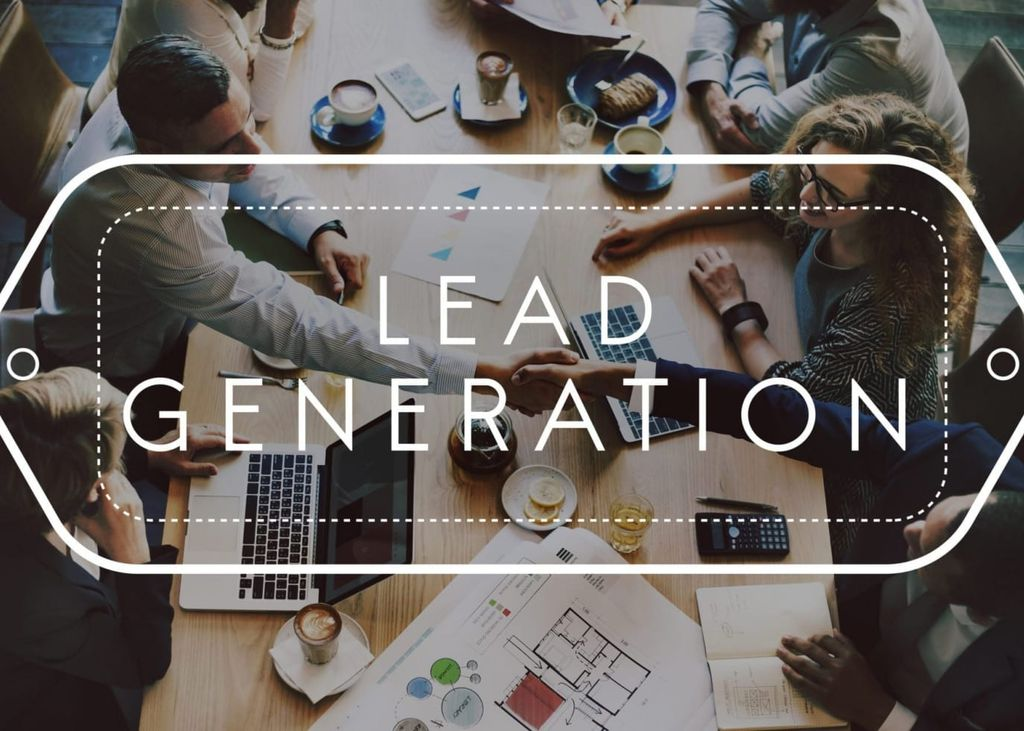 "Image of professionals seated around a table working with words ""Lead Generation"" imposed over the image"
