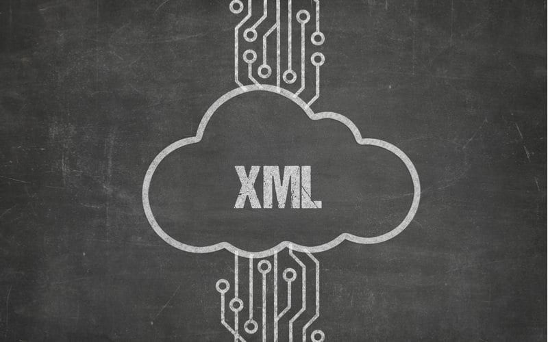 image of 'XML' inside of cloud outline with circuit board paths at the top and bottom