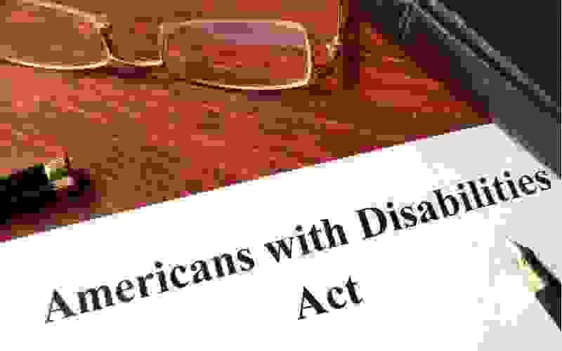 table with folder showing that says American with Disabilities Act