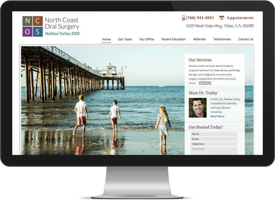 Screenshot of an oral surgeon website on a big monitor
